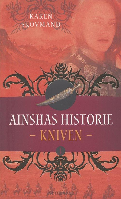 Image of   Ainshas Historie 1 - Kniven - Karen Skovmand Jensen - Bog