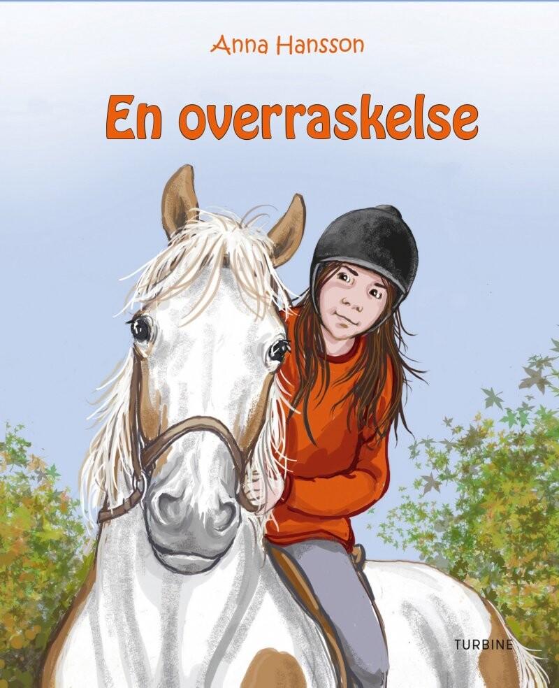 En Overraskelse - Rideskolen 6 - Anna Hansson - Bog