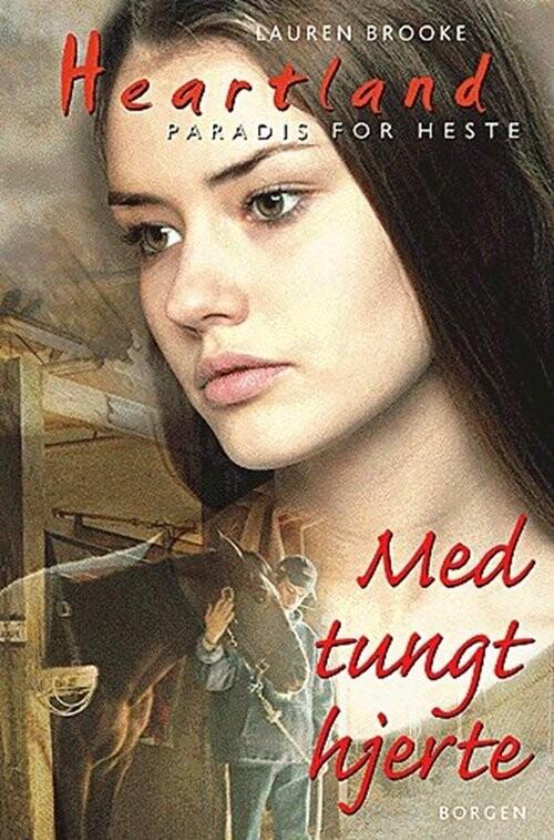 Image of   Med Tungt Hjerte - Lauren Brooke - Bog